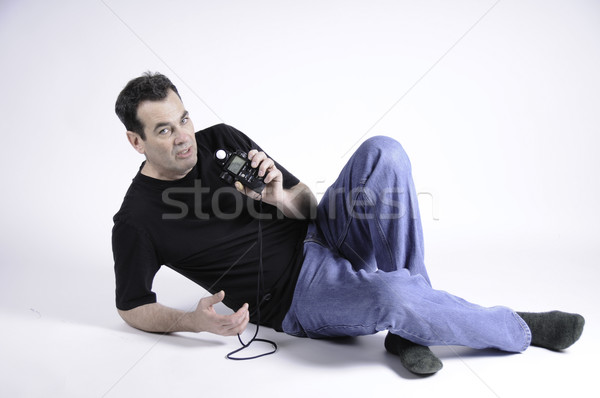 Man holding light meter Stock photo © stockfrank