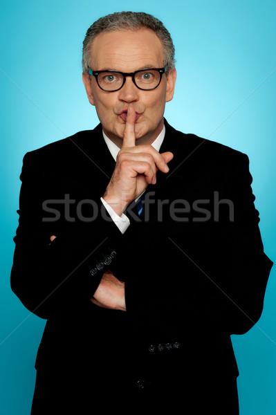 Silenzio imprenditore guardando dito labbra business Foto d'archivio © stockyimages