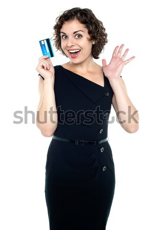 Fashionable woman holding cash card Stock photo © stockyimages
