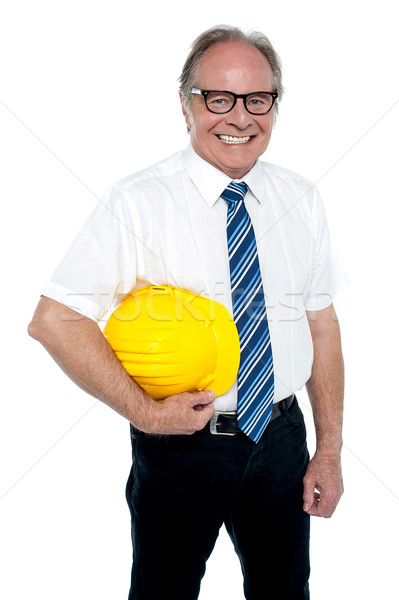 Smiling experienced architect posing with safety helmet Stock photo © stockyimages