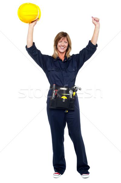 Jubilant female architect celebrating success Stock photo © stockyimages