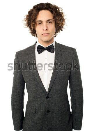 Handsome young bridegroom looking away Stock photo © stockyimages