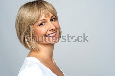 Stock photo: Smiling middle aged woman
