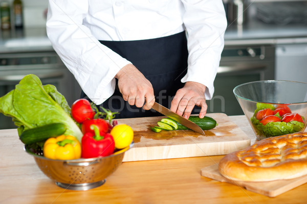 Chef chopping vegetables Stock photo © stockyimages