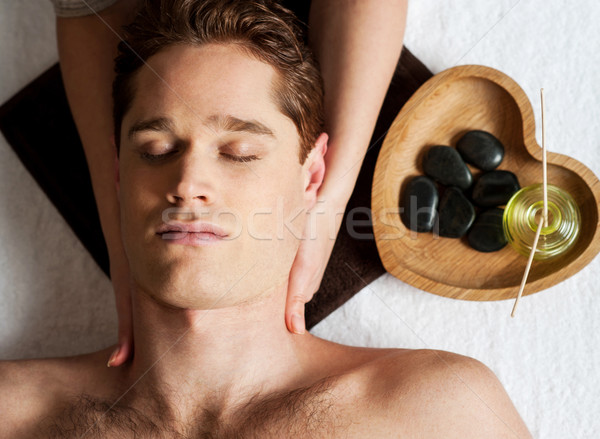 Stock photo: Young man getting face massage