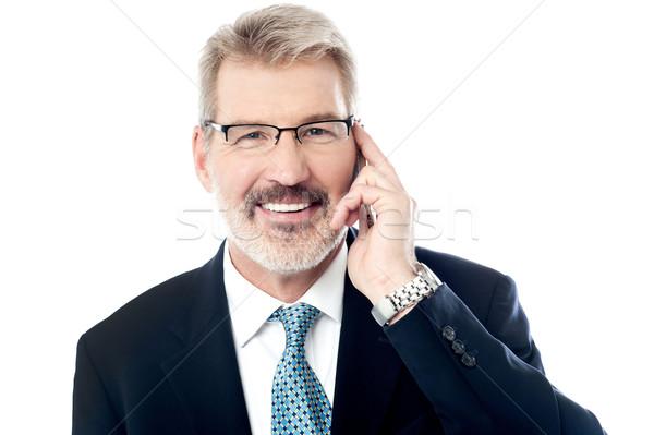 Hello érett üzletember mobiltelefon üzlet férfi Stock fotó © stockyimages