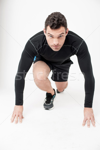 Male runner in starting position Stock photo © stockyimages
