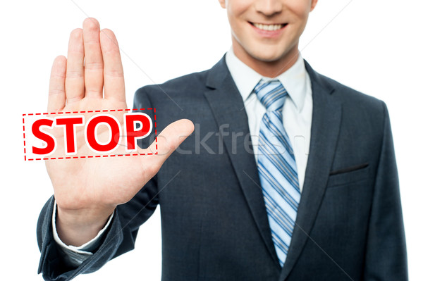Hand raised with stop message Stock photo © stockyimages