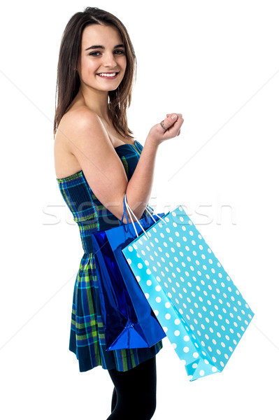 Sideways of shopping teen girl.  Stock photo © stockyimages