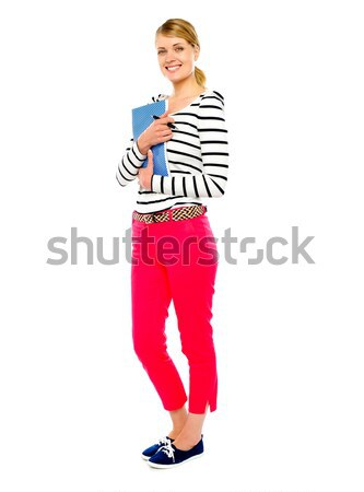 Gorgeous lady posing with pen and notebook Stock photo © stockyimages
