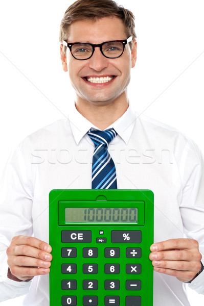 Corporate man showing big green calculator Stock photo © stockyimages