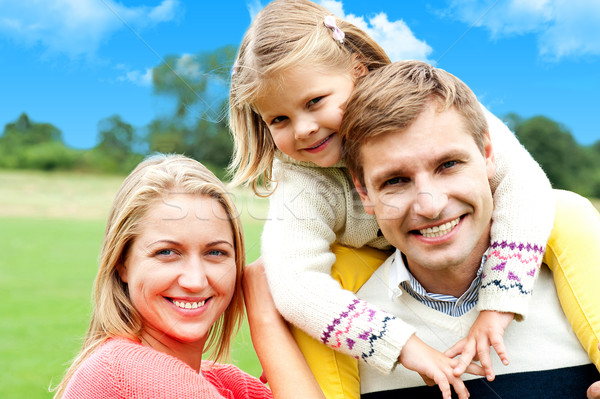 Beautiful happy caucasian family of three Stock photo © stockyimages