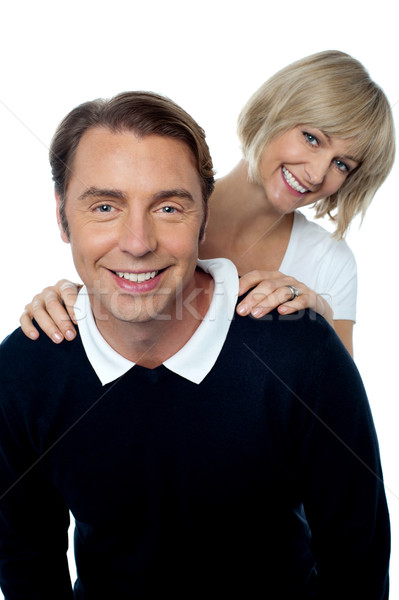 Love couple posing casually in front of camera Stock photo © stockyimages