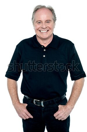 Profile shot of a casual smiling retiree Stock photo © stockyimages
