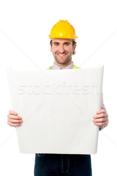 Mannelijke bouwvakker blauwdruk jonge architect Stockfoto © stockyimages