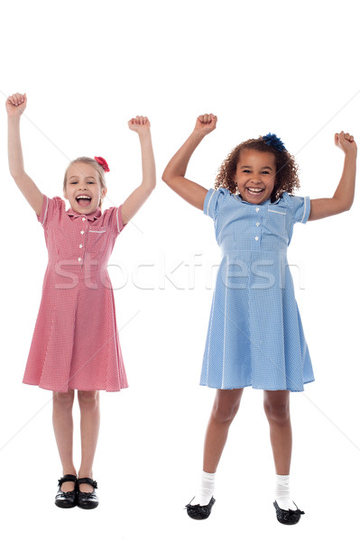 Two excited young girls in joyous mood Stock photo © stockyimages