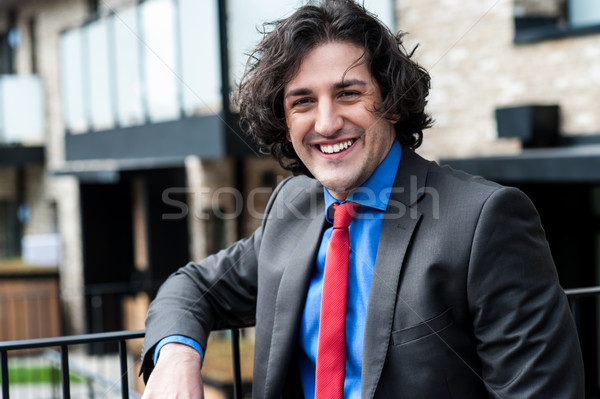 Smart male professional posing casually, outdoors Stock photo © stockyimages