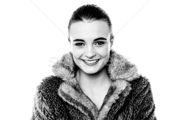 Smiling attractive girl in furry overcoat Stock photo © stockyimages
