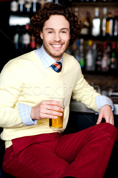 Young guy having chilled beer at bar Stock photo © stockyimages
