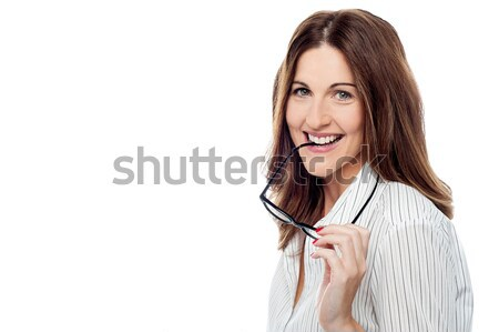 Smiling surprised pretty businesswoman Stock photo © stockyimages