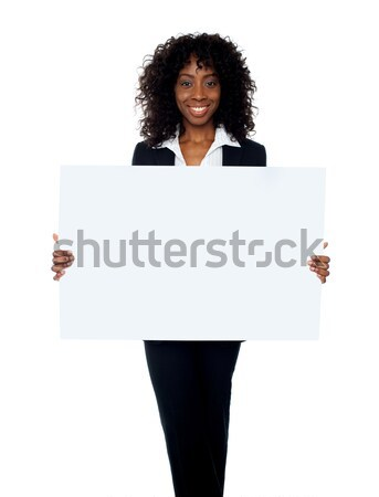 Corporate woman displaying white ad board Stock photo © stockyimages