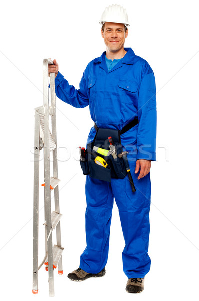 Repairman with a stepladder and tools bag Stock photo © stockyimages