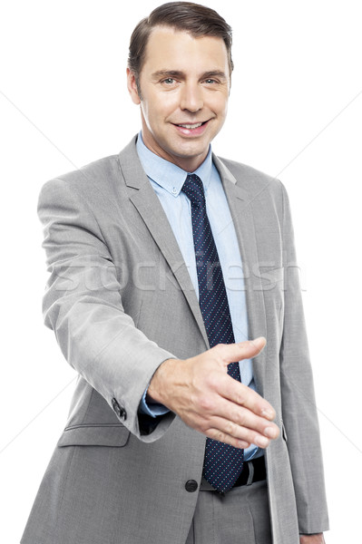 Executive welcoming you with a handshake Stock photo © stockyimages