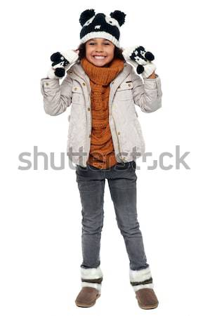 Charming young girl enjoying winters Stock photo © stockyimages