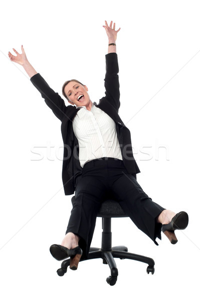 Business lady rejoicing in madness Stock photo © stockyimages