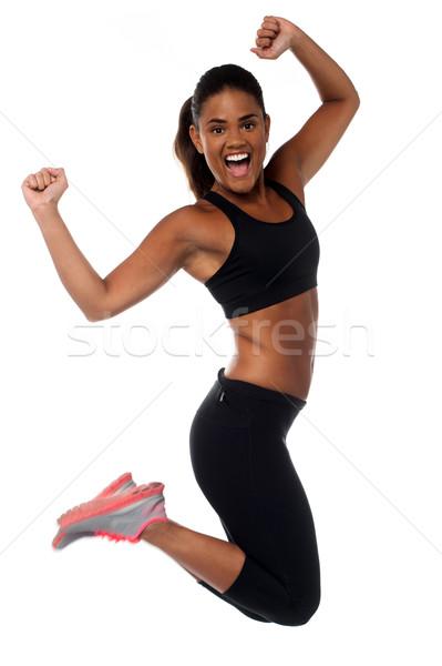 Kobieta odzież sportowa skoki radości piękna kobieta Zdjęcia stock © stockyimages