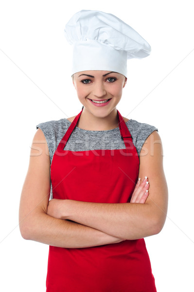 Cheerful young female chef Stock photo © stockyimages