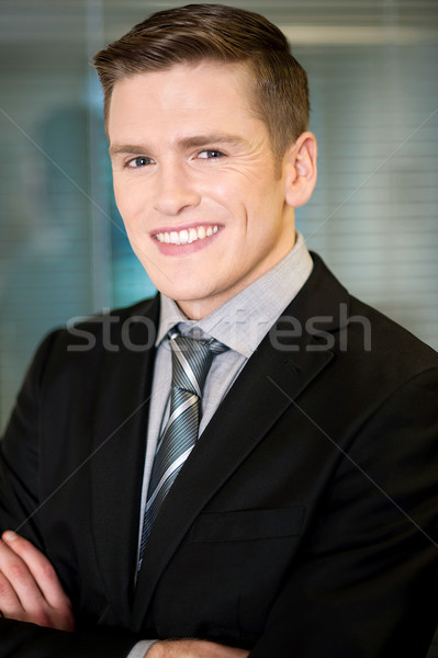 Smiling businessman posing confidently Stock photo © stockyimages