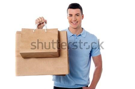 Zaman alışveriş genç alışveriş çantası adam Stok fotoğraf © stockyimages