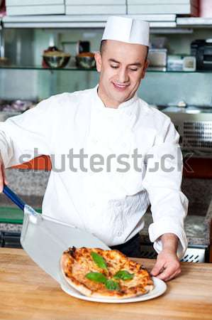 Chef with prepared pizza dough Stock photo © stockyimages