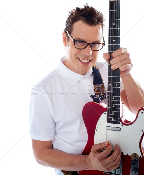 Erkek gitarist çekici oynama gitar Stok fotoğraf © stockyimages