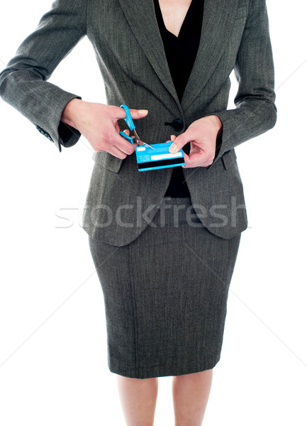 Cropped image of woman destroying credit card Stock photo © stockyimages