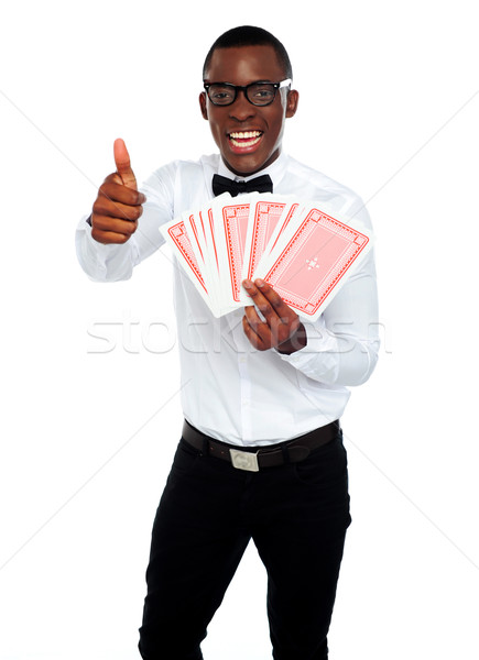Handsome man holding a trump. Thumbs-up Stock photo © stockyimages