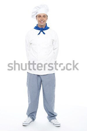 Smart young smiling male chef posing casually Stock photo © stockyimages