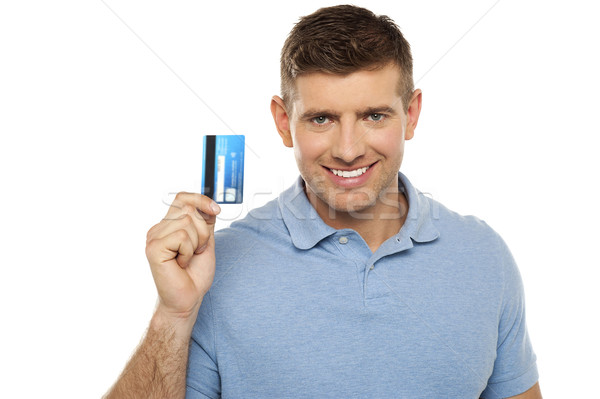 Cheerful man holding credit card Stock photo © stockyimages