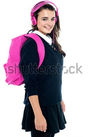 Iskolás lány rózsaszín hátizsák összeillő fejhallgató élvezi Stock fotó © stockyimages