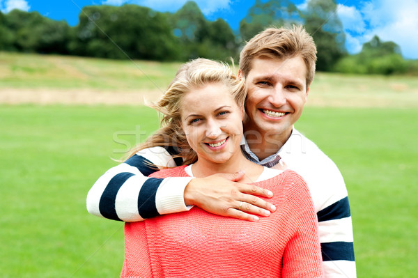 Husband hugging his wife from back Stock photo © stockyimages