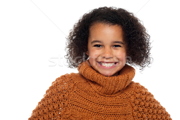 Snap shot of a stylish african girl in winter clothes Stock photo © stockyimages