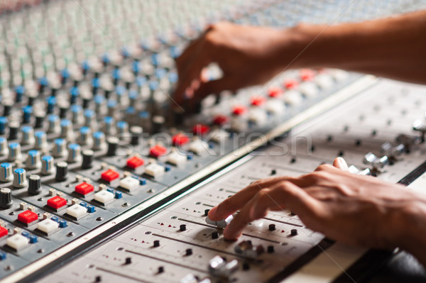 Editor adjusting the sound mixer Stock photo © stockyimages