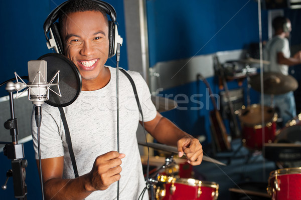 Singer recording his new track in studio Stock photo © stockyimages