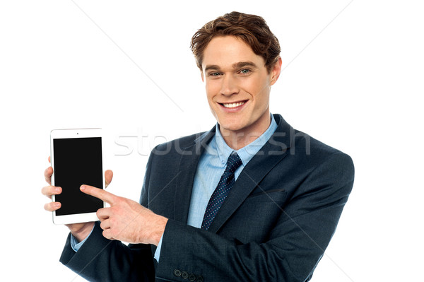 Businessman promoting newly launched tablet Stock photo © stockyimages
