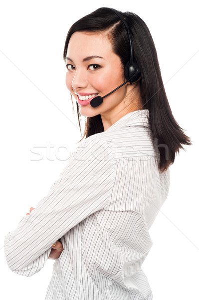 Smiling young call center executive Stock photo © stockyimages