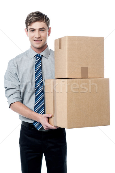 Young man with with stack of boxes Stock photo © stockyimages