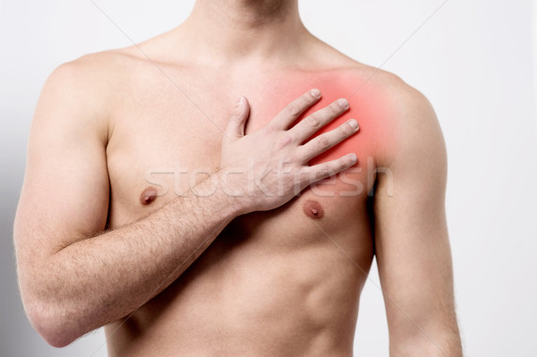 Man having chest pain, heart attack. Stock photo © stockyimages