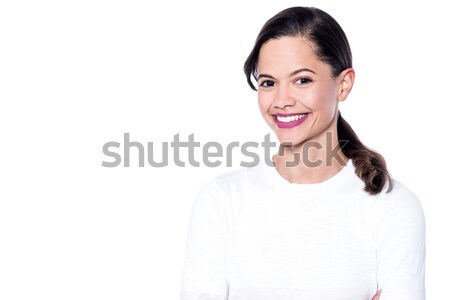 Young woman posing casually Stock photo © stockyimages