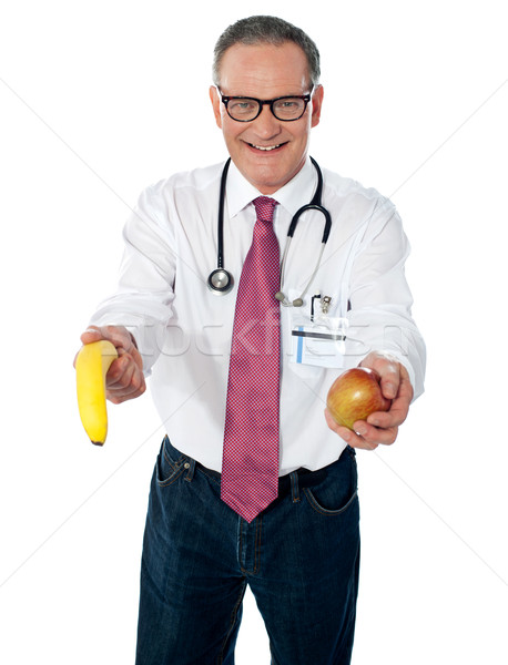 A fruit a day keeps doctor away Stock photo © stockyimages